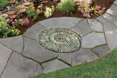 C mo hacer un mosaico de piedras for Como hacer un jardin con piedras