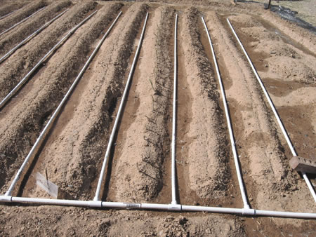 Sistema De Riego Por Goteo Con Tuberias De Pvc as well  furthermore Bag Drip Watering Kit besides 8 Inexpensive Diy Greenhouse Ideas Anyone Can Build also How Should I Install A French Drain In This Situation And Will It Help. on drip systems for gardens