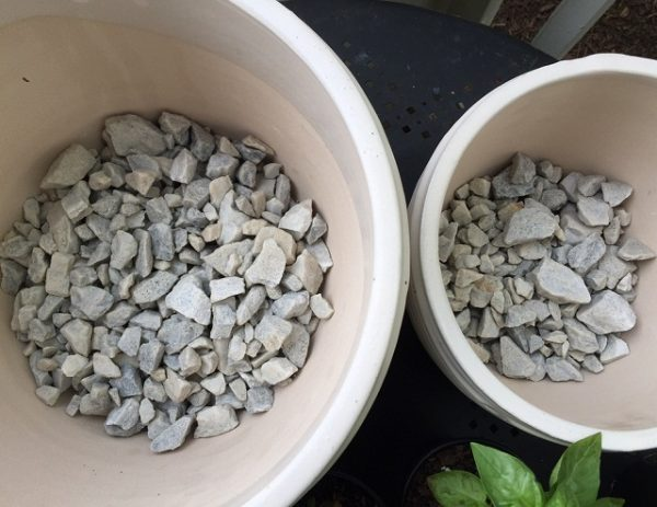 Why not use gravel in the pots? 1